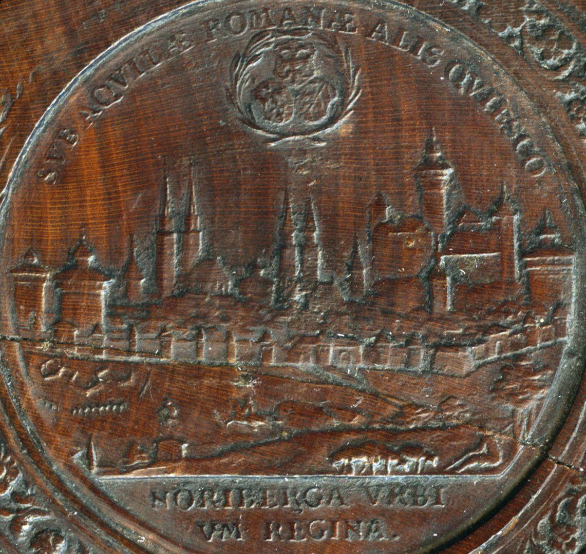 Spielstein mit Nürnberg Stadtansicht von Osten und Friedensallegorie Spielsteinseite mit Stadtansicht von Nürnberg, Detailansicht