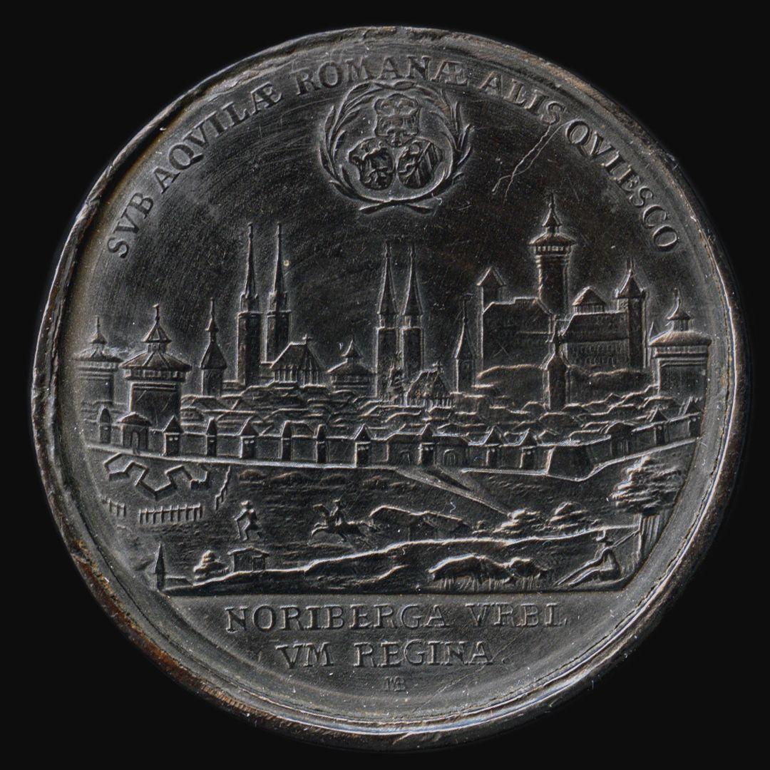 Spielstein mit Stadtansicht Nürnbergs von Osten und Friedensallegorie Spielsteinseite mit Stadtansicht von Nürnberg