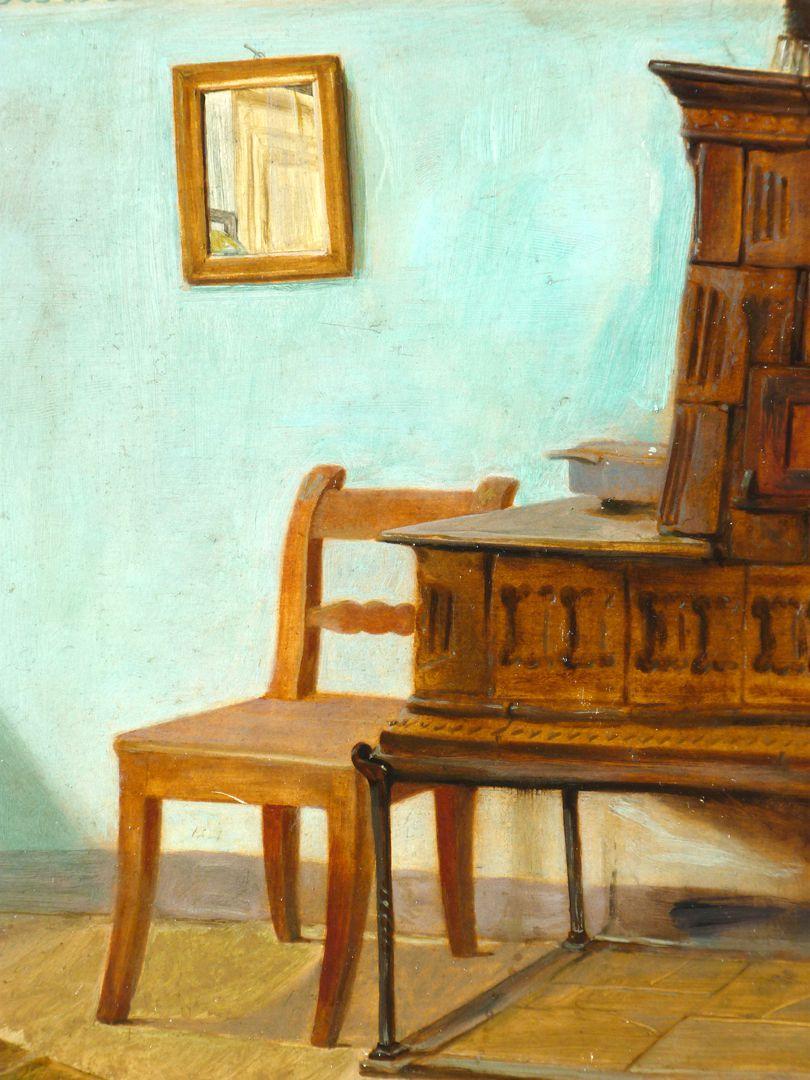 Alter Ofen Detailansicht mit Spiegel, Stuhl und Ofen