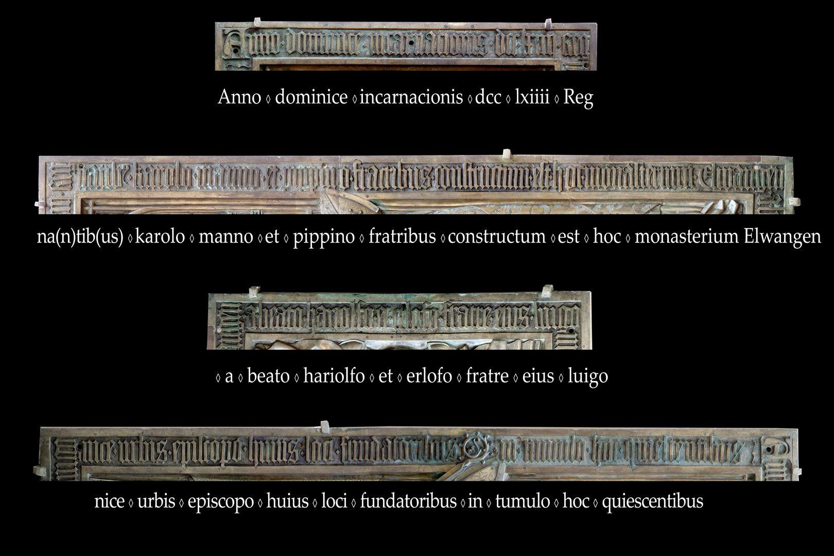 Memorienplatte für Hariolf und Erlolf Im Jahr der Menschwerdung des Herrn 764 als die Brüder Karlmann und Pippin regierten, wurde dieses Kloster Ellw. von den Gründern dieses Ortes, dem selig. Hariolf und seinem Bruder Erlolf, dem Bischof der Stadt Langres, errichtet. Sie ruhen in diesem Grab