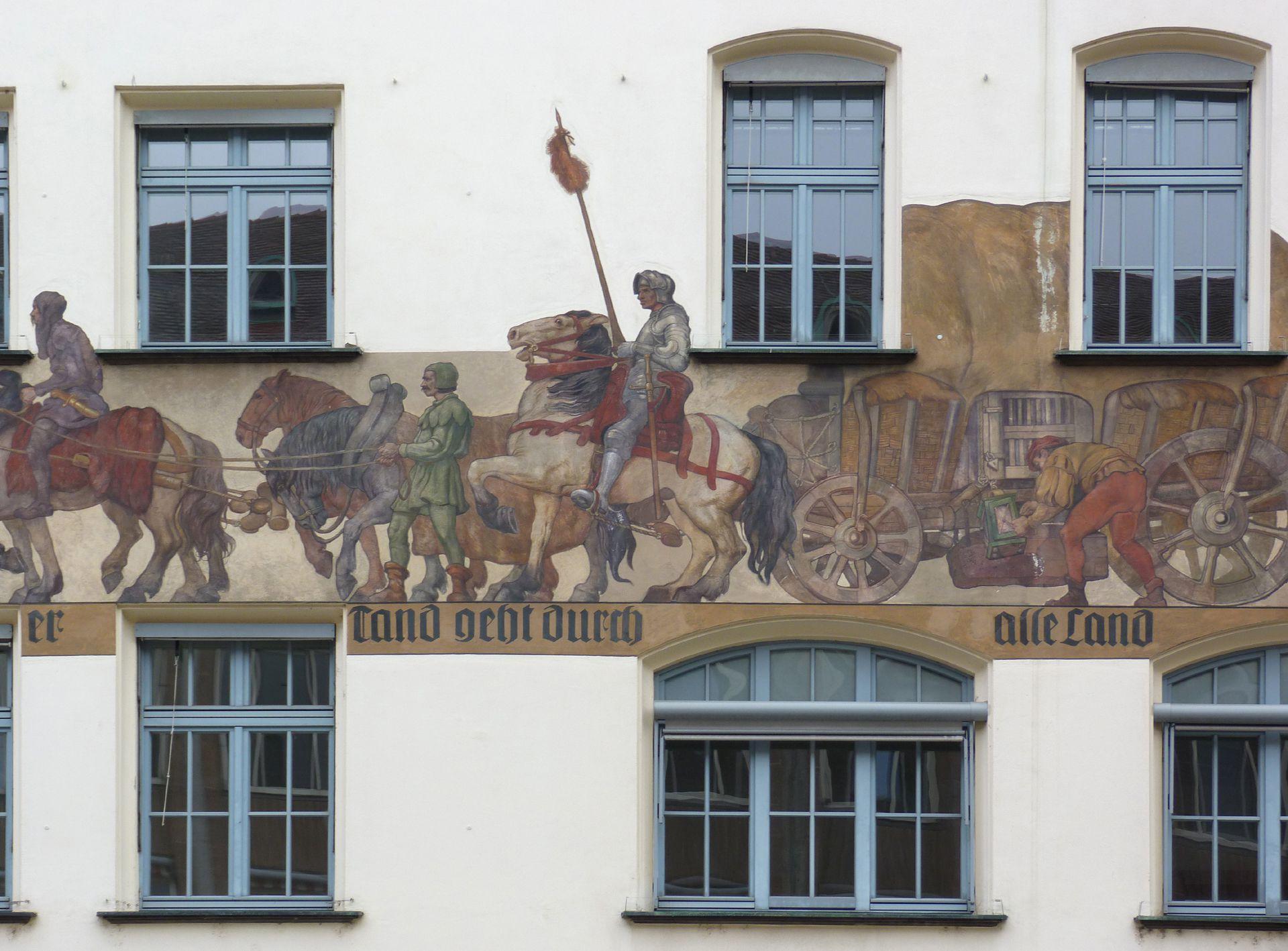 Kaufmannszug Ostfassade, Detail: Mittelteil des Zuges mit Wagen und Ritter