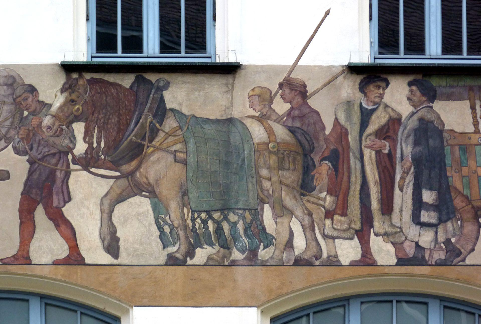 Kaufmannszug Ostfassade, Detail: Hinterer Wagen mit Knappen und Kaufleuten