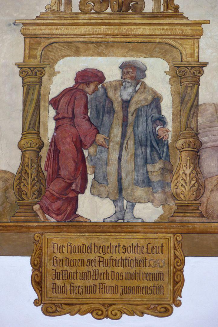 Kaufmannszug Südfassade, Allegorie des Überseehandels, Detail: Kaufgespräch und Spruchtafel