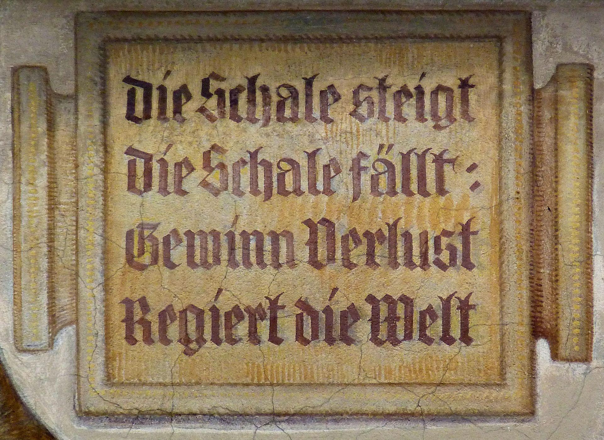 Kaufmannszug Südfassade, Waagenspruch