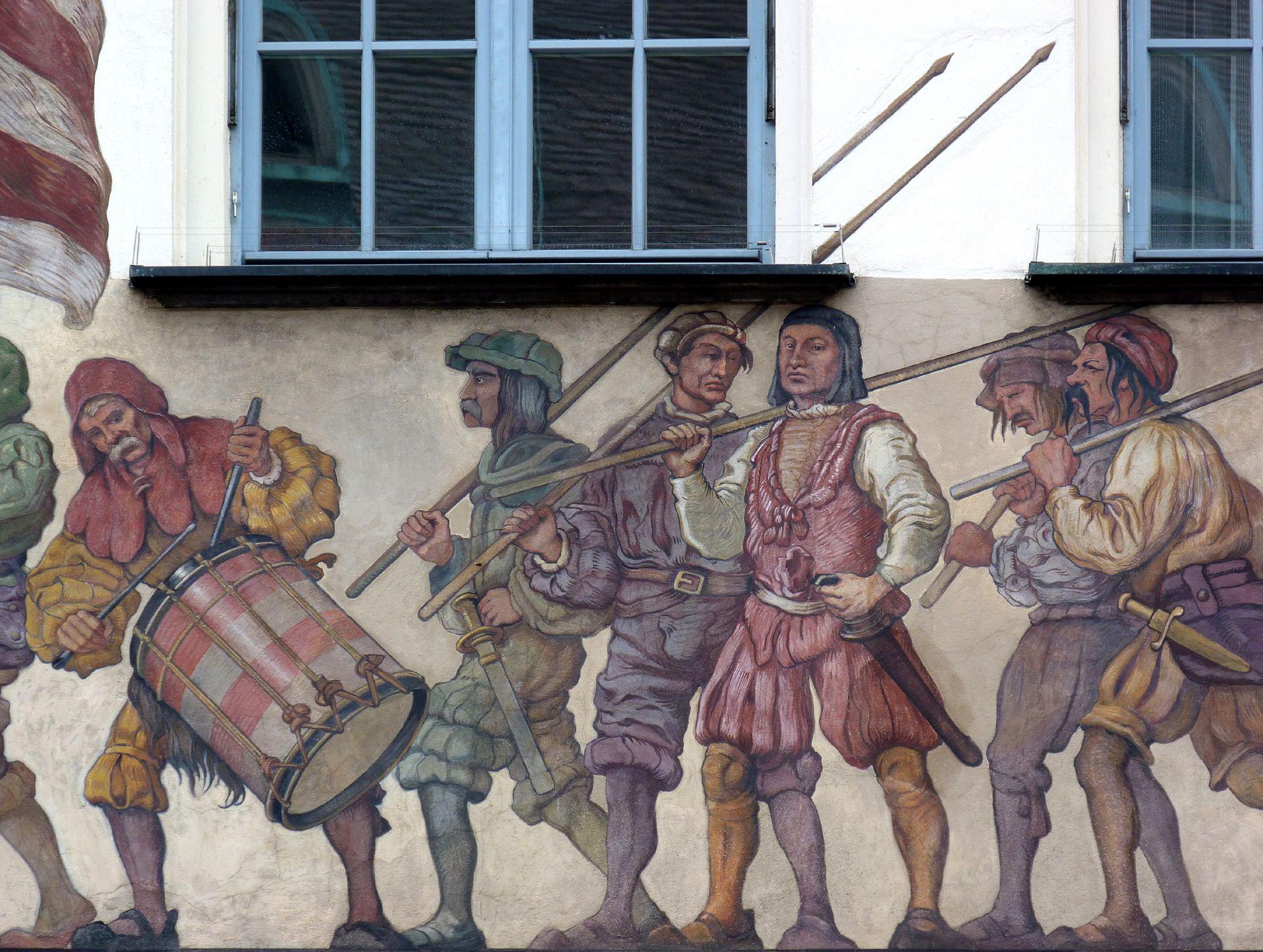 Kaufmannszug Ostfassade, Detail: Trommler und Schutzkolonne