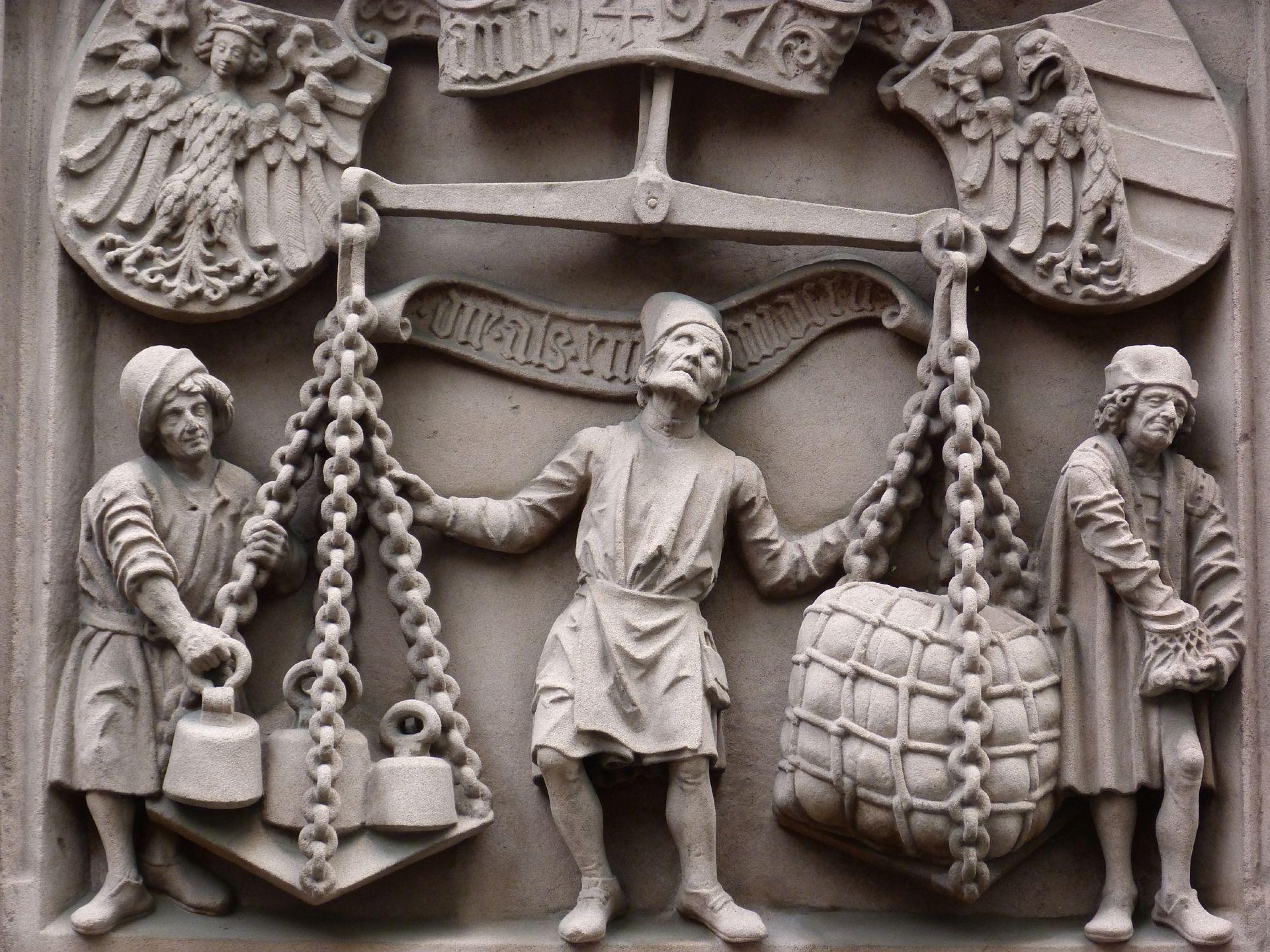 Waagrelief Detail des Waagemeisters, flankiert von Geselle und Handelsherr