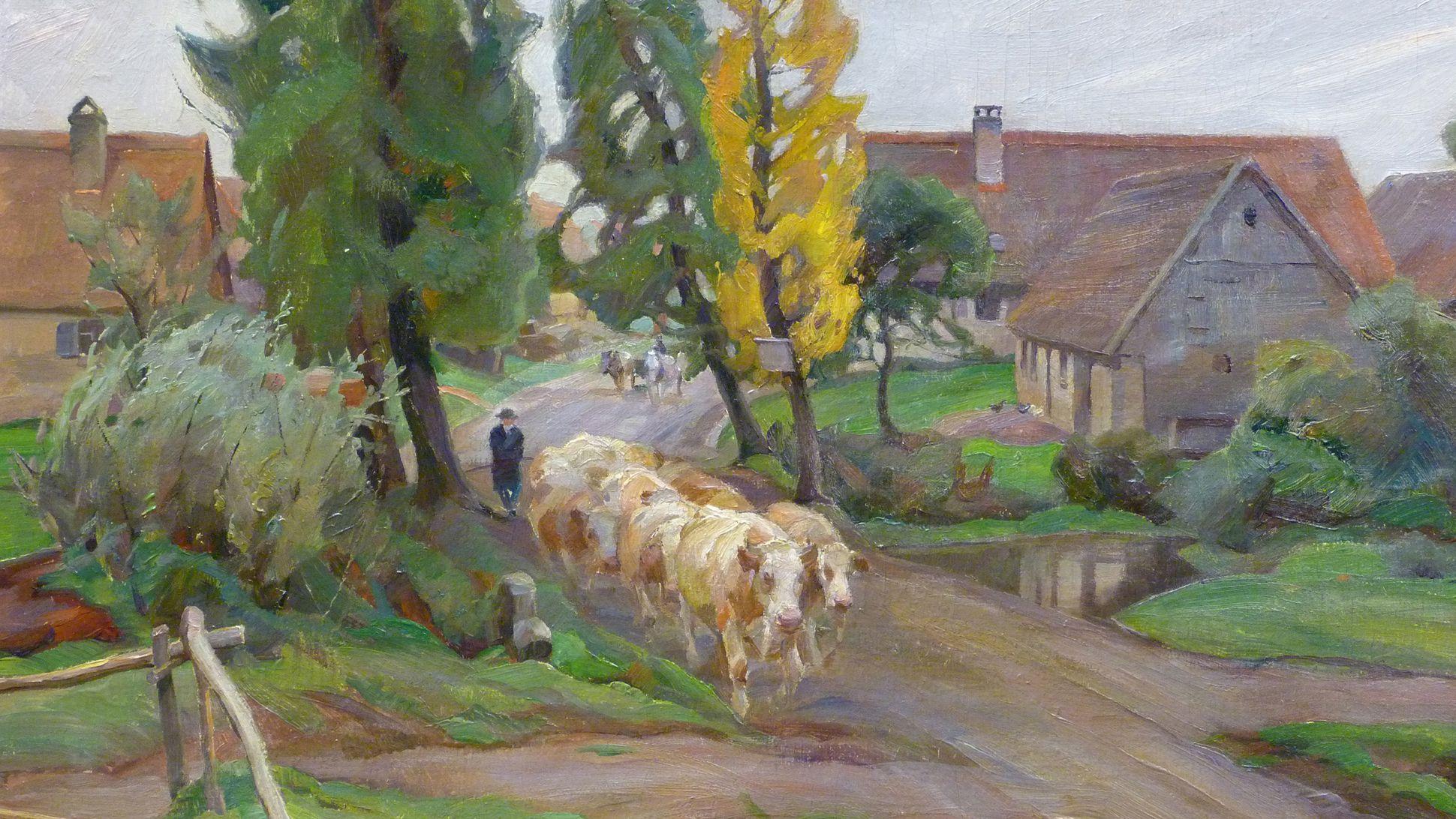 Kühe auf der Dorfstaße Bildmitte