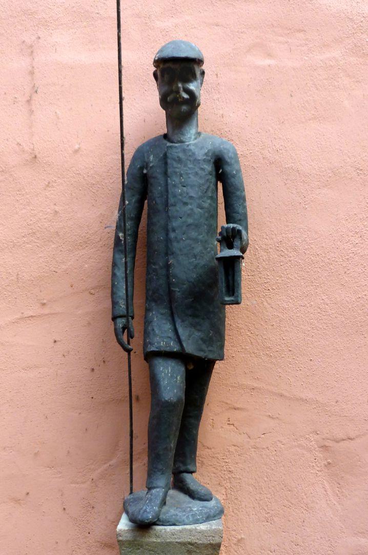 Laternenanzünderbrunnen Figur