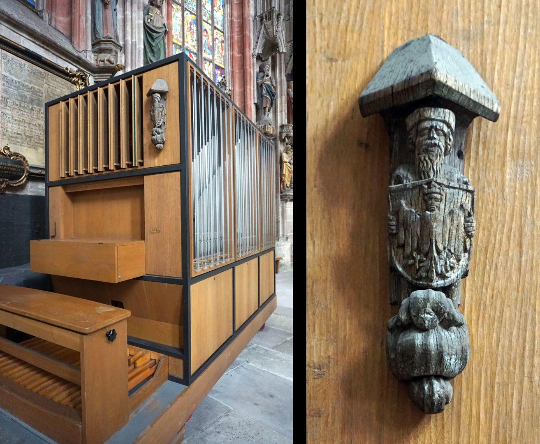 Traxdorfer Orgel Chororgel / Orgelbauwerkstatt Willi Peter, Köln von 1976, Detailfoto mit Fragment aus der alten Orgel, ein Mann hält das Stadtwappen von Nürnberg